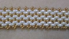 IVORY BRACELET WHITH SUPER DUO