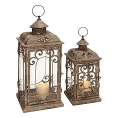 Deco 79 Scrollwork Caging Candle Holder Metal Glass Lantern Set of Two 52949 New Lantern Set, Lantern Candle Holders, Candle Holder Set, Square Candles, Lanterns Decor, Rustic Lanterns, Decorating With Lanterns, Large Candle Lanterns, Hurricane Lanterns