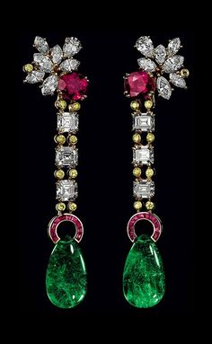 Earrings featuring 2 Burmese rubies for 5.52cts set with diamonds for nearly 10 cts, Fancy Yellow brilliant cut diamonds and 2 Brazilian cabochon emerald drops for nearly 23cts. Set on yellow gold.