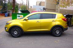 My 2011 Kia Sportage -  Electronic Yellow