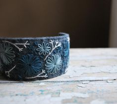 Felt Cuff Bracelet Hand Embroidered Wool with Shades of Blue Stitching by lovemaude via Etsy
