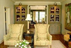 Pale greens, painted bookcases, damask, antiques - Marjorie Johnston & Co.
