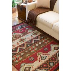 @Overstock.com - Add southwestern style to your home with this handwoven wool area rug. This unique transitional floor covering features geometric patterns in an array of colors. It has a flat-pile design and fringes along its width for added character.http://www.overstock.com/Home-Garden/Hand-woven-Red-Tan-Southwestern-Aztec-Louise-Wool-Flatweave-Rug-5-x-8/5995958/product.html?CID=214117 $157.49