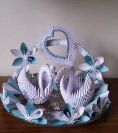 Very nice wedding decoration or wedding gift. Both swans, arc and heart were made using modular origami techniques.Wedding swan plate 1 by akvees on Etsy Origami Design, Diy Origami, Origami Star Box, Origami Wedding, Origami Fish, Origami Dragon, Quilling Paper Craft, Paper Crafts Origami, 3d Paper