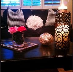 these pillows would look great with my brown couch.  Love the decorations on coffee table.
