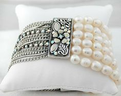 Champagne/Lace Colored Pearl Stretch Bracelet with Silver Accent and Strands JewelryStylist,http://www.amazon.com/dp/B00747SNC4/ref=cm_sw_r_pi_dp_MgHTrbB2E1C74C8A