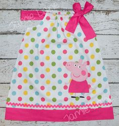 This custom made Peppa Pig dress turned out so cute. I made the dress with a pretty polka dot with hot pink polka dot tie and hem with hot pink