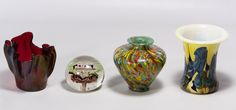 """Lot 402: Art Glass Assortment; Four items including a blue abstract floral vase, a multi-color splatter style vase, an """"AC"""" decorated patriotic paperweight and a red folded rim bowl marked """"Klyon 95"""" on the underside"""