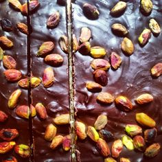 Trick or treating for grown ups. Coconut candy topped with dark chocolate and toasted pistachios ....mmmmm