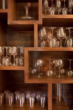 Use old shelf in guest room, add wallpaper to front facing back side and refinish to create shelf for glasses. Brilliant!