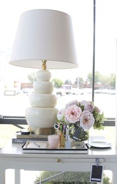 alice lane home collection - what's in store | pink peonies, pink candle, ivory lamp, white desk