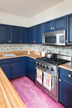 Blue kitchen cabinets and tile backsplash