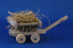 "Hand made wooden, Hay Wagon for your Christmas scene or nativity.  From Bavaria, Germany, 2-1/2"".  Available at www.mygrowingtraditions.com"