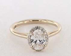 14K Yellow Gold Pave Halo Diamond Engagement Ring with an Oval Diamond | Oval Diamond Engagement Rings | Yellow Gold Engagement Rings | James Allen ring style: 17307Y14 #engagementring