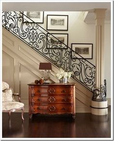 Iron scroll staircase wrapping around the pillar creates a nice flow.
