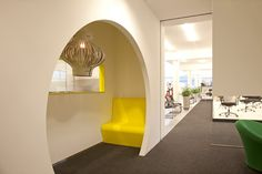 Sheltered area in an office, love the pop of yellow.