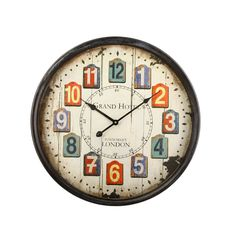 """Furnistar Retro Wall Clock Faux Wood Chip Numbers """"Grand Hotel"""". This fun retro wall clock features a black frame surrounding large easy to read numbers each painted onto faux wood pieces. The words Grand Hotel adorn the distressed off white background above long slim black hands. This clock looks lovely on a kitchen living room or bedroom wall and makes a wonderful housewarming wedding or anniversary gift"""