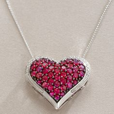Silver heart pendant with rubies.