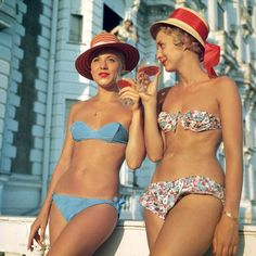 Two bikini-clad holidaymakers enjoy a glass of wine outside the Carlton Hotel, Cannes. Photo by Slim Aarons, Slim Aarons is an iconic photographer, who worked mainly for society publications, taking pictures of the rich and famous. As well as. Slim Aarons, Slim Keith, Daphne Guinness, Bikini Modells, Bikini Clad, Bikini Tops, Richard Avedon, Carlton Hotel Cannes, Serpieri