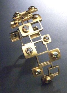 Cuff | Haroldo Burle-Marx. 18k gold with smokey quartz. ca. 1960.