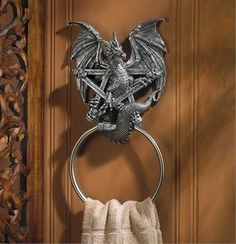"""Medieval Dragon Bathroom Towel Ring""...apparently I'm not the only one into powder room wizardry."
