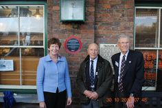 Tallylyn Railway, April 2011. Institution President Prof Isobel Pollock presenting the award to two volunteers at the railway.
