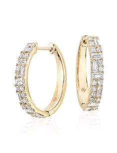 This Colin Cowie hoop earring features a unique pattern comprised of round, princess, and baguette cut diamonds set in 14k yellow gold.