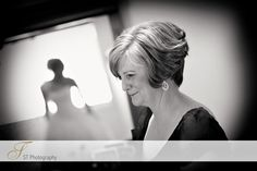 Beautiful shot of the Mother of the Bride, with bride's reflection in the background.