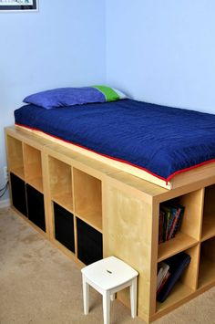 Expedit storage bed, made from 5 Expedit shelves from Ikea.This would be excellent in a dorm room, plus there is room under the mattress for things like luggage and off season clothing.