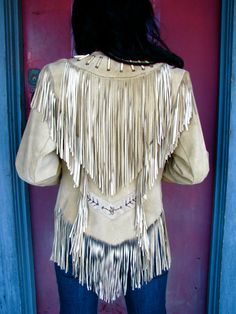 WANT!!  vintage.  circa 1970s.  women's suede.  very Cher, Indian-esque.  fabulous, light-colored tan suede, fully fringed, front and back.