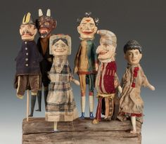 """Six Carved & Painted Punch & Judy Puppets. C. 1900. Max. Ht. 18""""."""