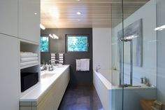 Vanglo House by LWPAC & Vanglo (7). Modern bathroom, grey and white