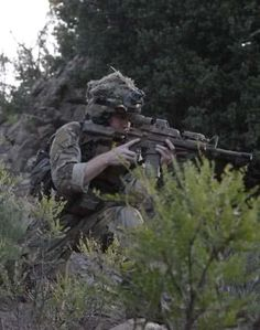 A member of an International Security Force engages a Taliban facilitator in the Suri Kheyl section of the Zadran district of Afghanistan Aug. 14, 2010. (U.S. Army photo by Spc. Enoch Fleites/Released)