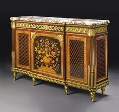A FINE LOUIS XVI STYLE GILT BRONZE MOUNTED MAHOGANY, EBONY, FRUITWOOD MARQUETRY AND PARQUETRY MEUBLE À HAUTEUR D'APPUI Paris, late 19th century Estimate  25,000 — 35,000  USD  LOT SOLD. 28,125 USD