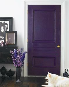 Doors to each different room painted vibrant different colours.