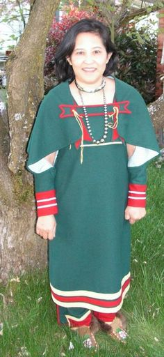 Anne in her Ojibway Strap Dress, sleeves and leggings by Shea Munroe. Lined in a blue calico