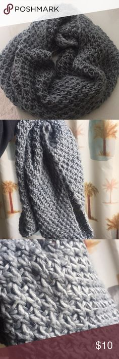 Knit Infinity Scarf Gray knit Infinity scarf with silver lining throughout. Super thick and chunky for winter to stay warm. Like new condition bc of barely any wear. Accessories Scarves & Wraps