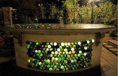 A DIY outside bar made out of concrete and different colored wine bottles- would be a super cool project :)