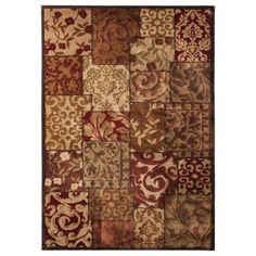 Target area rug, warm colors and soft/spiral/floral design.