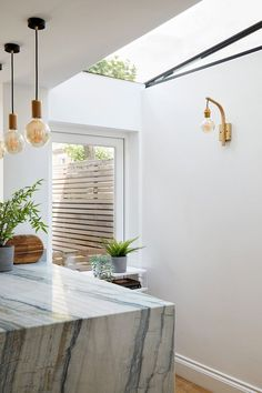 Photo Credit: Anna Stathaki #sidereturnglazing #quartziteworktop #marbleisland #walllight #fwallscounce #mapart #bornandbredstudio #kitchenideas #extension #sidereturnextension #islandlighting #pendantlighting #theavesqueenspark #queenspark #theavenues #queensparkconservationarea