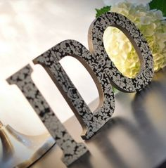 Damask wedding inspiration You could buy the letters from Michaels and do it yourself.