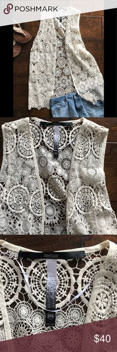 😎NWT Kensie Crochet Vest - M - Sold out in stores Festival plans? You need this brand new Kensie vanilla vest—delicate and in perfect condition. Excellent for summer concerts—I can almost hear the music and see the bathroom line from here. Size M. No flaws (I checked). I added pics of me wearing it—the tag is catching on the threads in the last picture but I don't want to remove the tag—it's not a flaw, just wanted to say why it's pulling funny. Kensie Tops