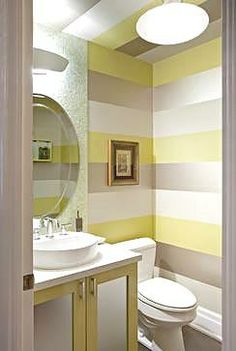 Since there is less surface area to cover, powder room wall treatments are less costly than they would be for any other bathroom in the home, so it's the perfect excuse to make a statement with a bold pattern. Plus, the space is confined, so the design won't interfere with any other design elements in your home.