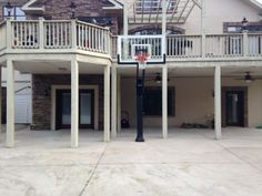 There is the front view of his Pro Dunk Gold Basketball System in front of his residence. Behind the hoop you can see his balcony.