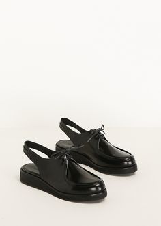 Patent leather oxford slingback wedge by Rachel Comey in black. Leather, rubber. Made in Peru.