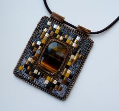 I love how the beads around the cabochon almost look like a pixelated version of the stone.