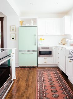 """For some reason, I was adamant that I wanted a mint green fridge in my all-white kitchen. I spent months and months researching brands and styles until I ended up deciding to go with the Retropolitan refrigerator by Big Chill."""