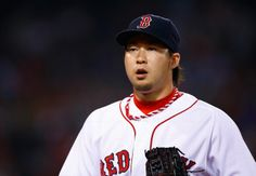 BOSTON, MA - JUNE 17: Junichi Tazawa #36 of the Boston Red Sox pitches in the 8th inning against the Minnesota Twins during the game at Fenway Park on June 17, 2014 in Boston, Massachusetts. (Photo by Jared Wickerham/Getty Images)
