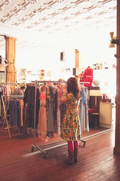 fall colored flowers on full-skirted dresses worn with bright tights & boots to thumb through racks of vintage gems