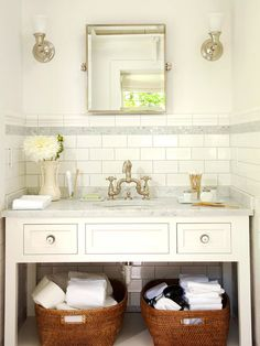 Love the marble top vanity and baskets below!